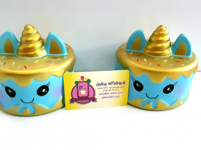 کیک یونیکورن طلایی آبی