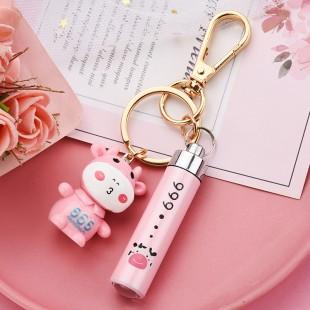 جاسوئیچی طرح گاو همراه با چراغ قوه جیبی Cute cow with mini flashlight keychain
