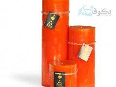 شمع کنار سالنی با رنگ نارنجی